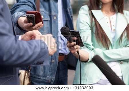 Journalists making interview with businessman or politician. News conference.