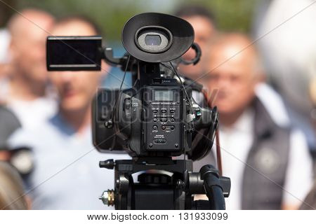 Video camera. News conference or media interview.