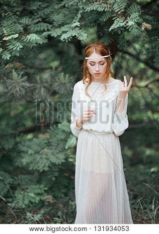 Beautiful Artistic Photo Portrait Of A Mysterious Girl In White Dress In The Woods