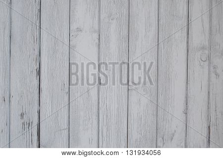 Close up of white wooden fence panels. wooden planks, wooden background