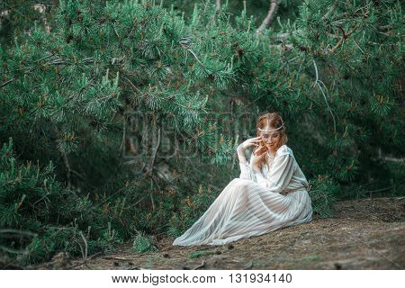 Beautiful Artistic Photo Ginger Girl In White Dress Sitting On The Ground In The Woods