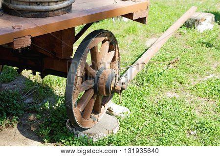 wooden cartwheel closeup summer day on grass