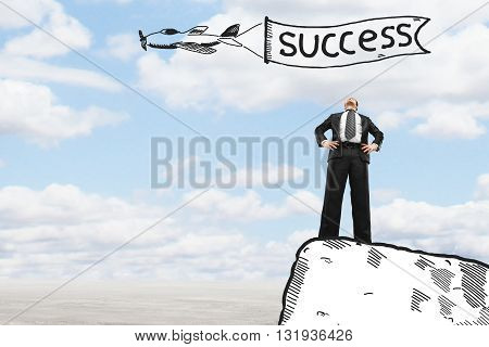 businessman standing on edge the cliff success concept