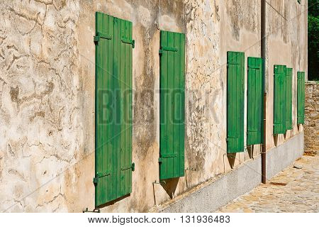 Еру Italian Windows with Closed Wooden Shutters