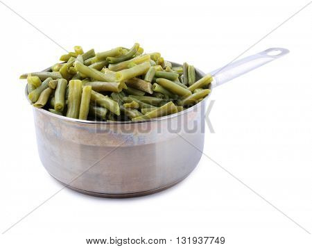 Green beans in a metal pan on white background