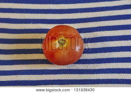 tomatoe on white blue textile close up