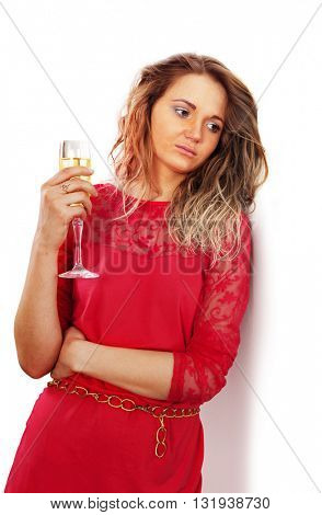 sad woman with a glass of red wine in kitchen