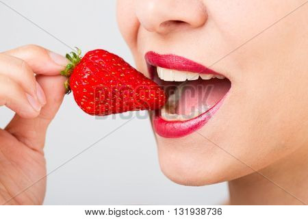 woman mouth with strawberry