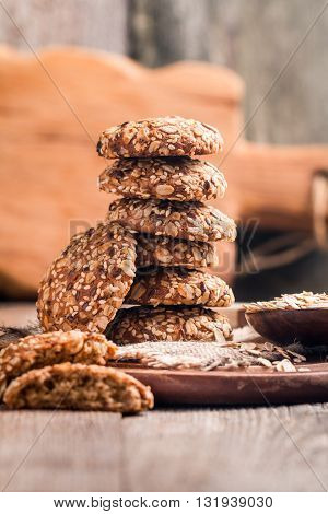 Oatmeal cookies on burlap and rustic wooden table