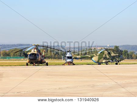 MOSCOW REGION - AUGUST 25:  Three russian military transport helicopters at the air base airfield  on August  25, 2015 in Moscow region