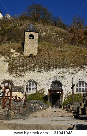 Haute Isle France - february 29 2016 : the tloglodytic Annonciation church and the cemetery