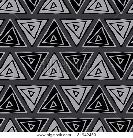 Ethnic seamless pattern. Tribal triangles seamless gray background