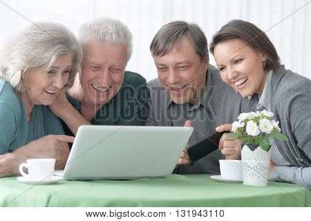 Portrait of a happy smiling family with laptop