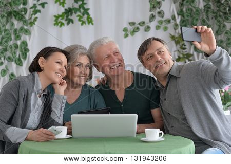 Portrait of a happy family taking selfie with phone