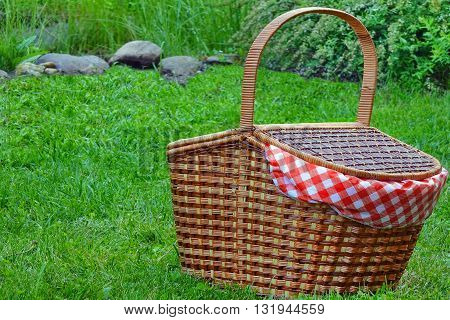 Picnic Basket On The Fresh Summer Lawn Closeup Side View