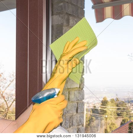 Woman Who Washes The Windows Of The House
