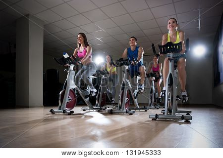 Young people on bikes indoors