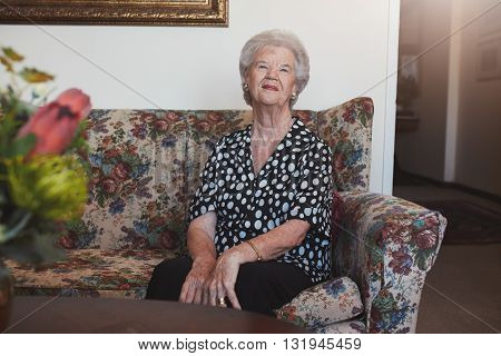Senior Woman Relaxing At Old Age Home