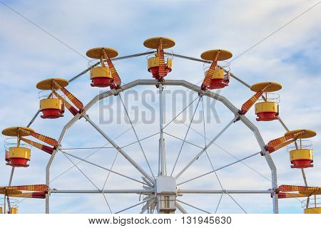 Ferris wheel in the park amusement with cloudy blue sky background