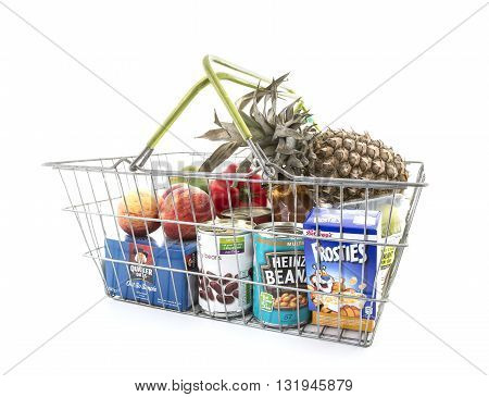 SWINDON UK - MAY 30 2016: Selection of Vegtables and Groceries in a wire Shopping Basket