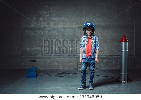 Boy with helmet in studio