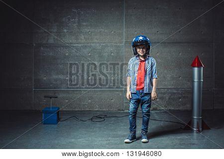 Boy with helmet in studio