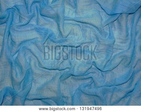 transparent blue fabric on white background , made of cotton,