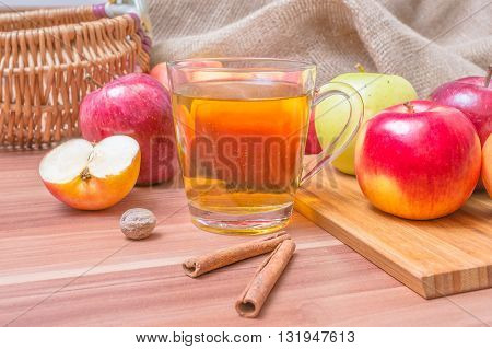 Hot Apple Drink Cider And Apples With Cinnamon On Table.