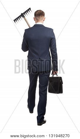 Young businessman with briefcase and rake goes doing hard work in office, view of back. Isolated on the white background.