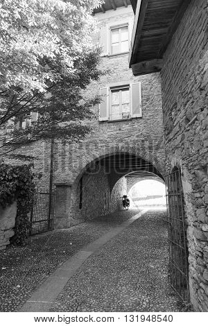 Montevecchia (Lecco Brianza Lombardy Italy): historic village a typical alley. Black and white