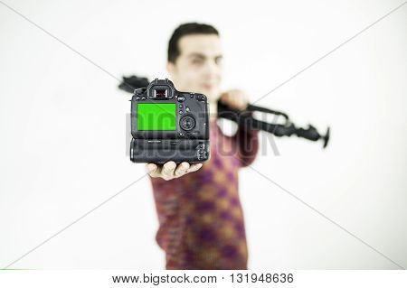 DSLR camera in hand isolated. Green screen