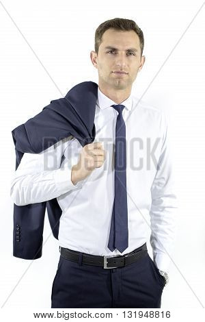 handsome Hispanic elegant man in black suit on grey background, holding the coat over his shoulder. Handsome young man with white shirt and tie carrying his jacket over shoulder isolated over white.