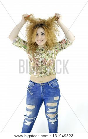 Curly girl shows the index finger forward. background.