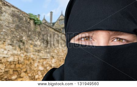 Eyes Of Young Woman In Black Niqab Scarf. Arabian Culture Concep