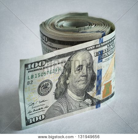 Cash Money.US dollars bundle close up on a textural background .