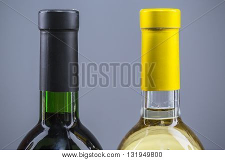 Wine bottles in a row isolated on a white background.