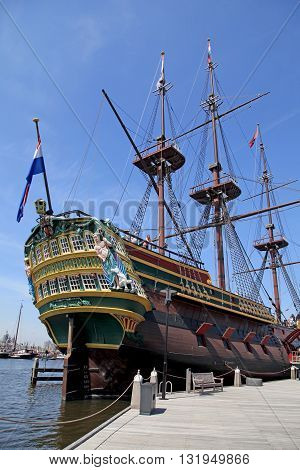 AMSTERDAM, NETHERLANDS - MAY 6, 2016: The ornate Dutch sailing cargo galleon ship of 17th century near Maritime museum, Amsterdam, Netherlands