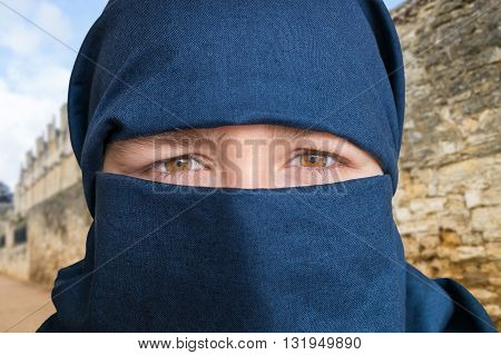Eyes Of Young Woman In Blue Niqab Scarf. Arabic Culture Concept.
