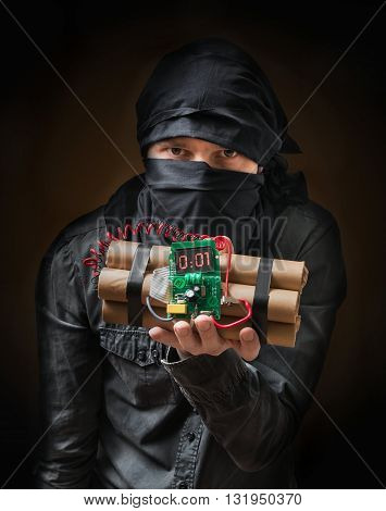 Terrorist Holds Dynamite Bomb In Hand. Low Key Photo.