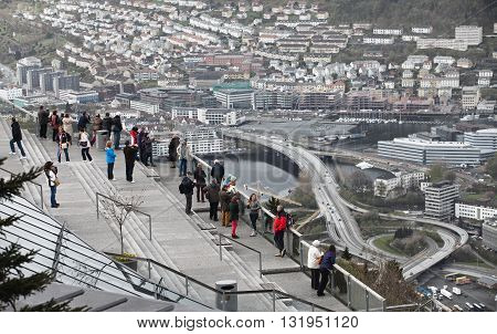 BERGEN, NORWAY - MAY 11, 2012: Tourists are looking down to Bergen from viewpoint
