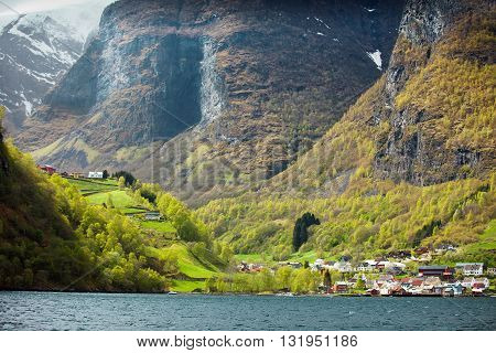 Settlement in narrow valley on the coast of norwegian fjord