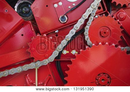 Red Gear wheel and chain part of machine