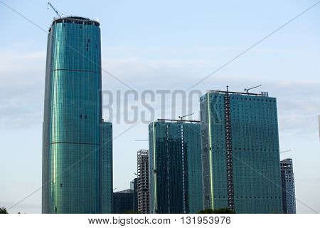 The skyline of Seattle with new buildings under construction. abstract glass side of business building