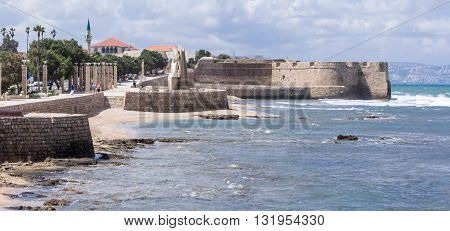 A fragment of the city wall and promenade in the city of Acre in Israel