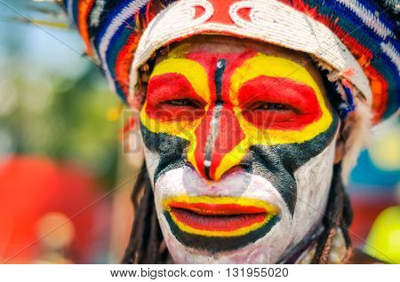 Colourful Face Of Man In Papua New Guinea