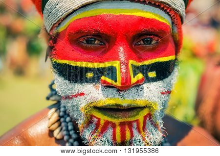 Man With Face In Colours In Papua New Guinea