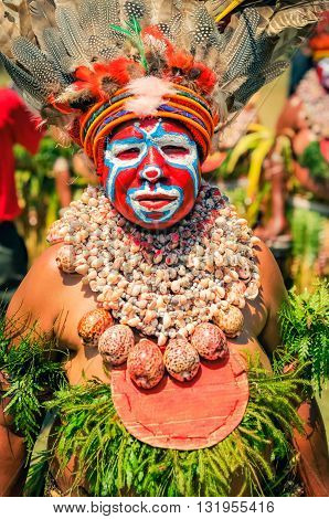 Woman With Seashells In Papua New Guinea