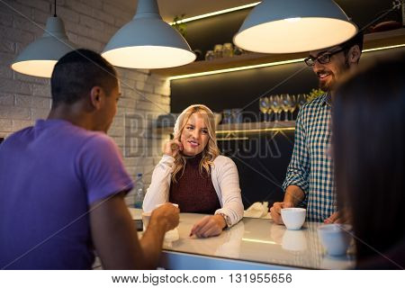 Young casual businesswoman working with colleagues at home.