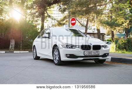 SOCHI, RUSSIA - APRIL 29 2016: BMW 525 parked in the streets of Sochi. BMW is a German automobile company founded in 1916. BMW 525 in sunlight