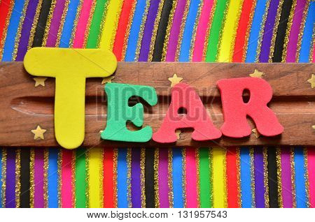 tear word on a abstract colorful background